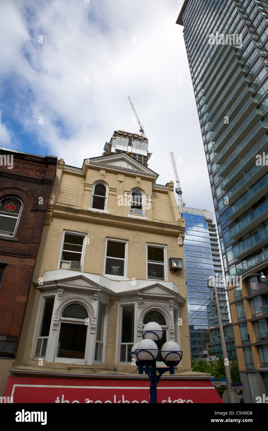 contrasting architecture between old and modern buildings skyscrapers and condos toronto ontario canada - Stock Image