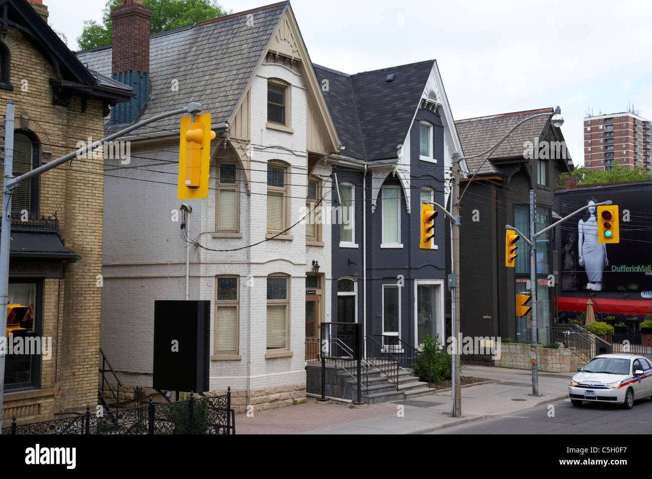 traditional victorian semi detached duplex town houses on avenue road toronto ontario canada - Stock Image