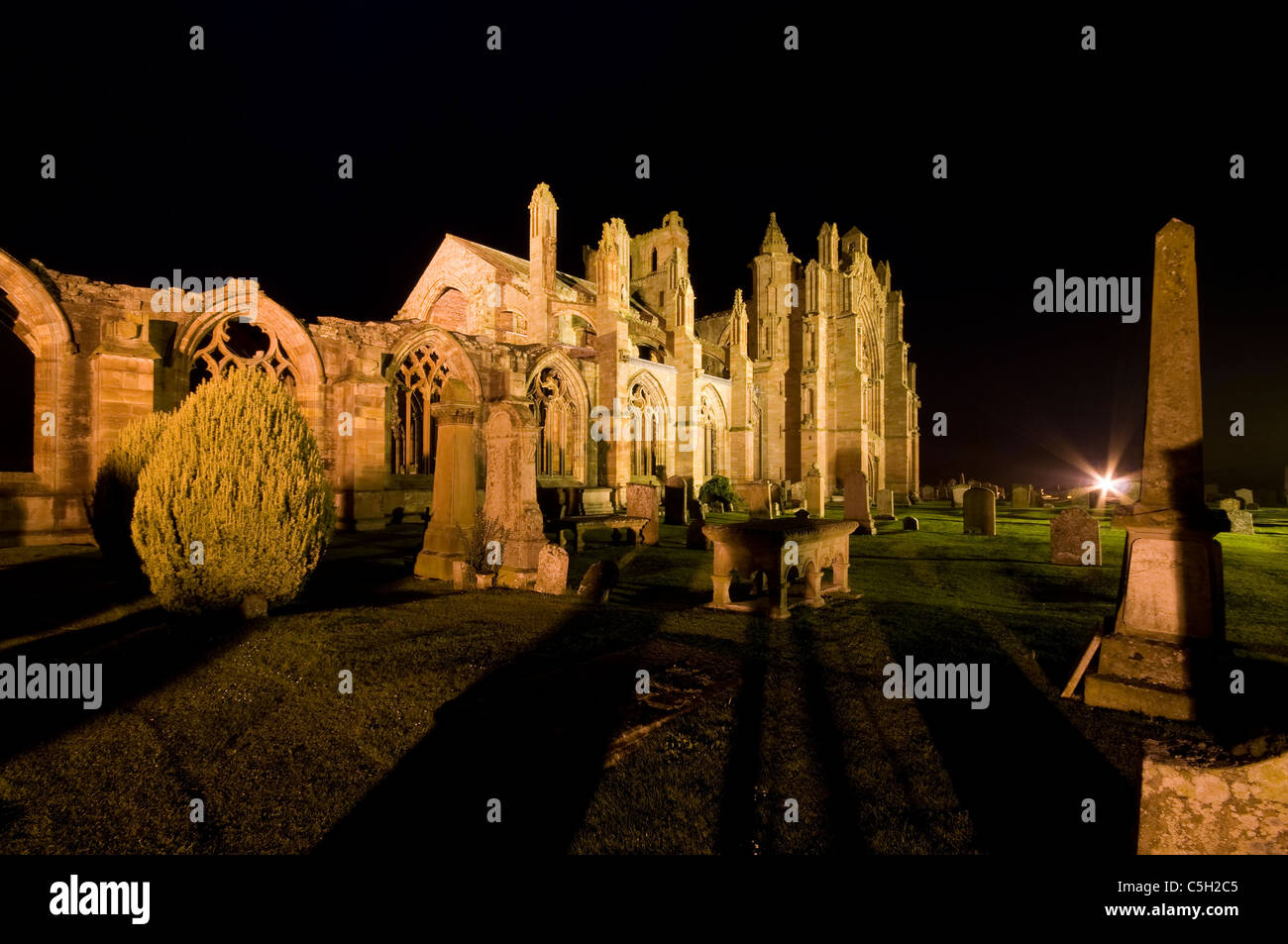 Melrose Abbey by floodlight - Stock Image
