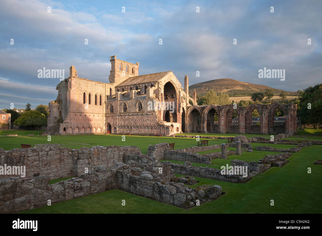 Melrose Abbey in late afternoon sunlight - Stock Image