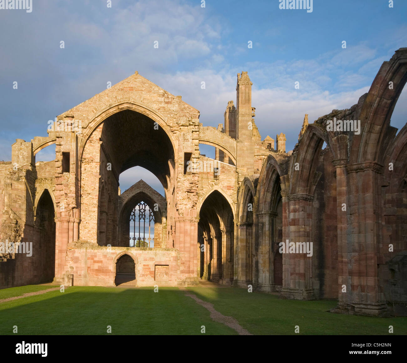 Melrose Abbey in late sun - Stock Image