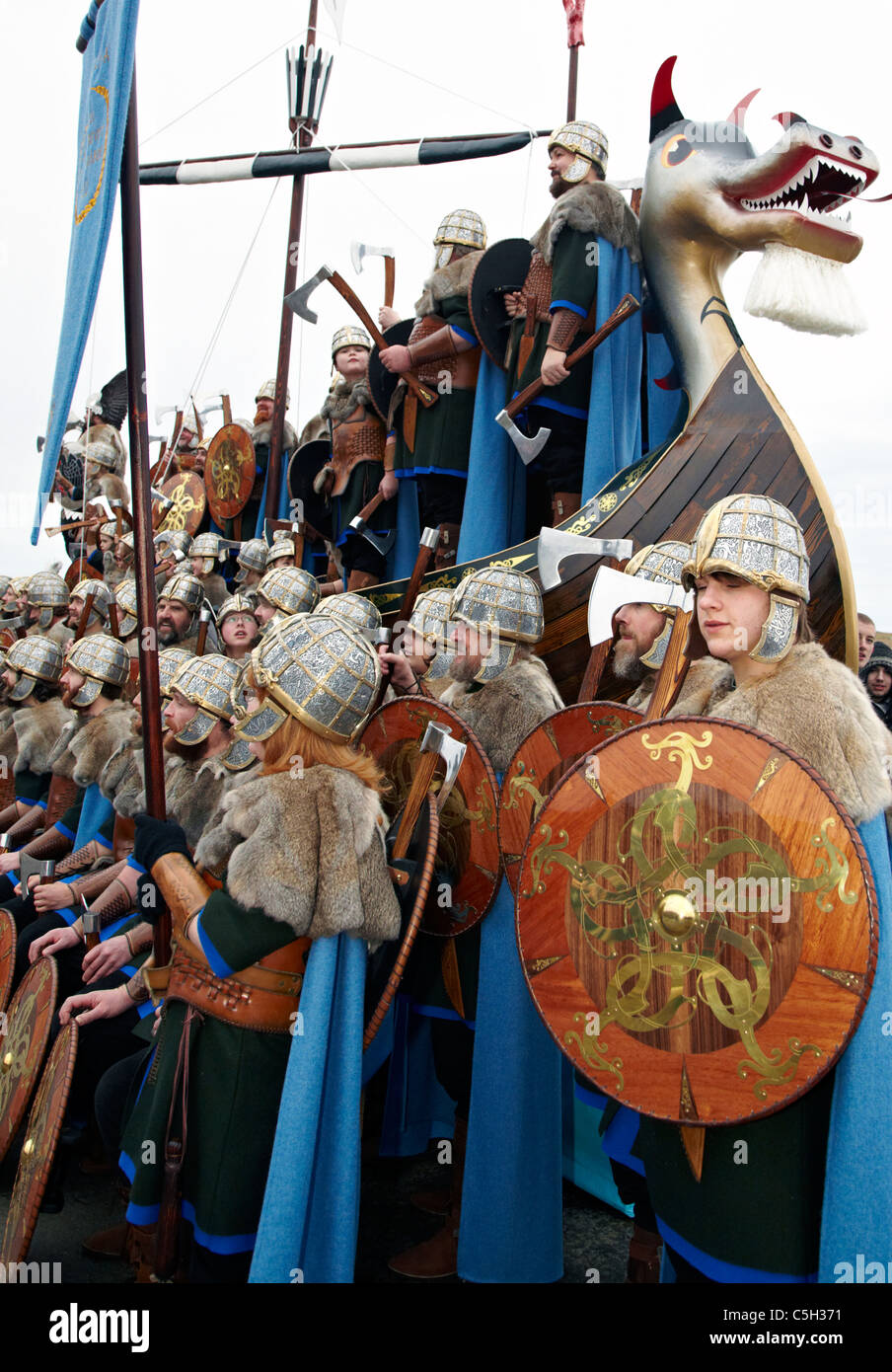 Vikings On A Longboat at the Up Helly Aa Fire Festival Shetland Islands - Stock Image