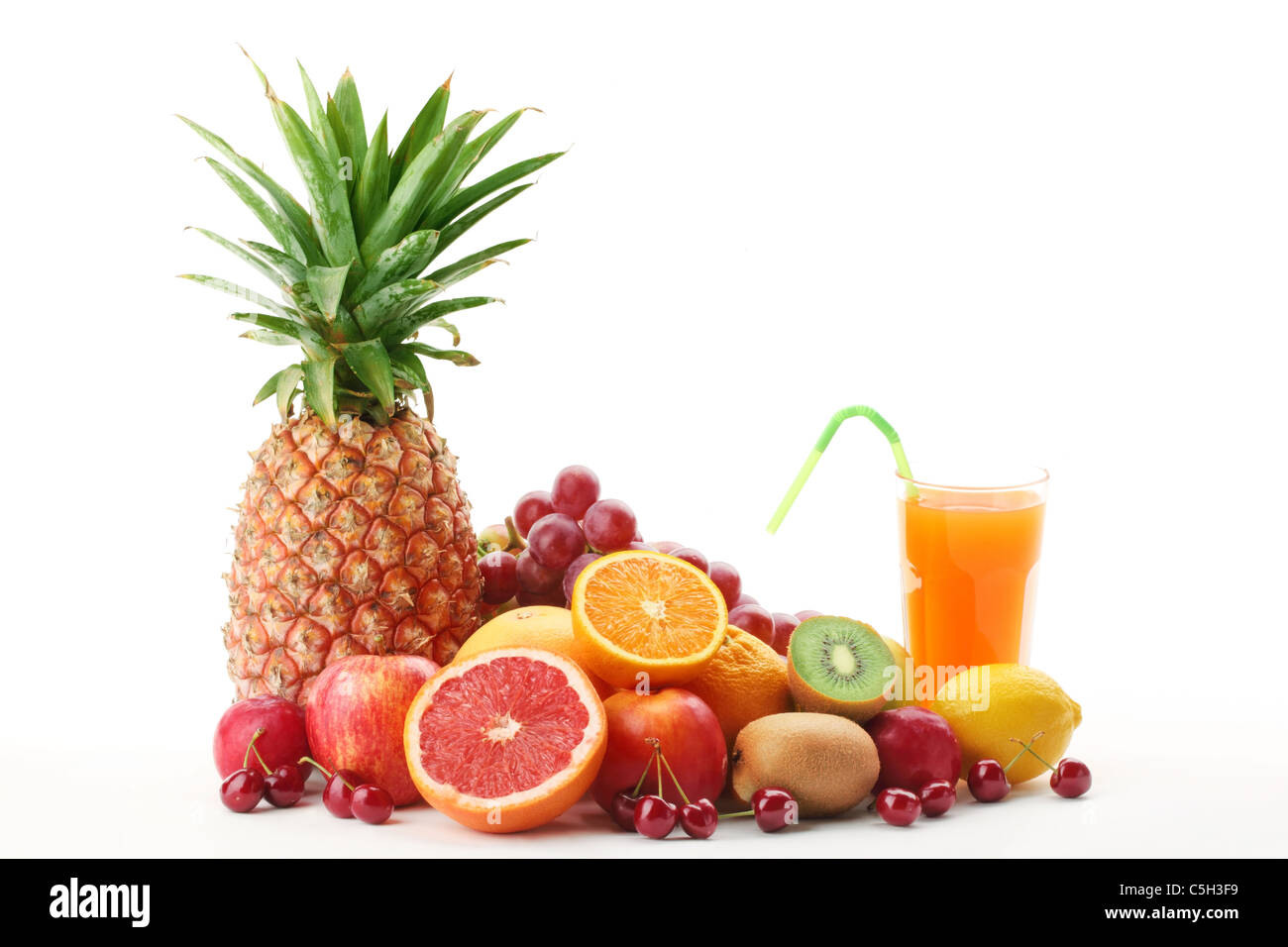 Pile of fruits with fruit juice on a white background. Stock Photo