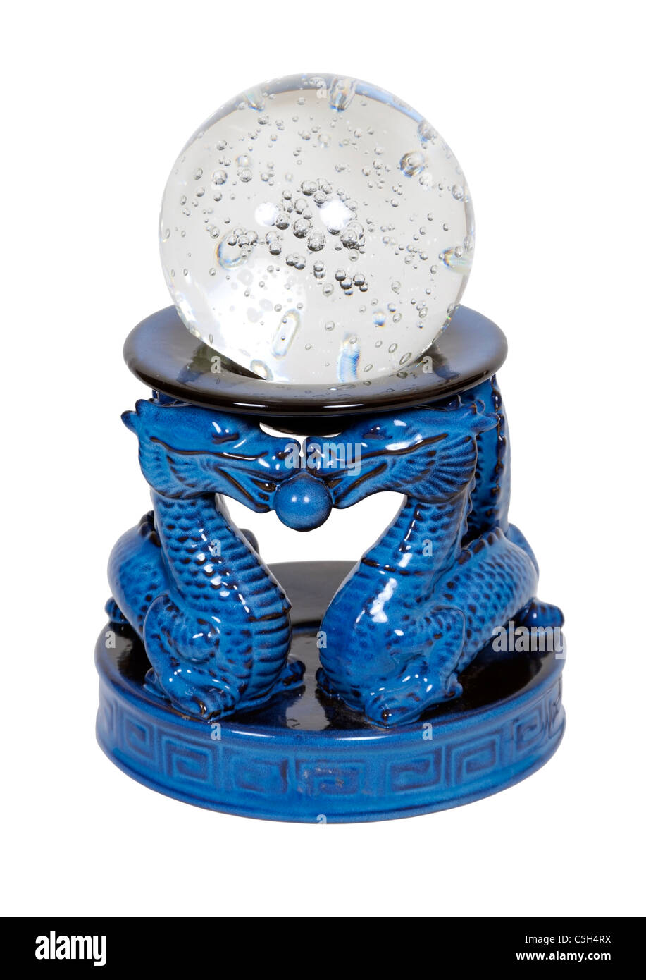 Crystal Ball on an asian dragon pedestal to hold up items of importance - path included - Stock Image