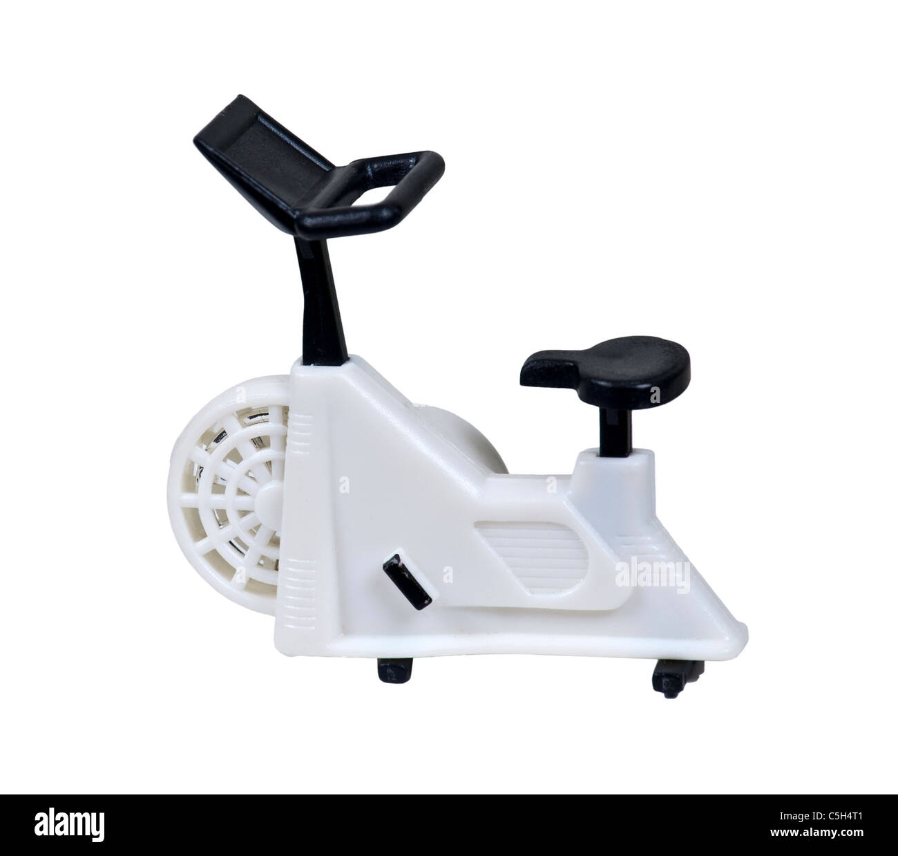 White exercise bike used for non-transport peddling for health fitness - path included - Stock Image