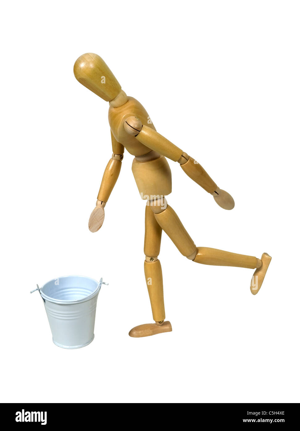 Kicking the bucket is a slang term meaning to die shown by a model kicking a white metal bucket - path included - Stock Image