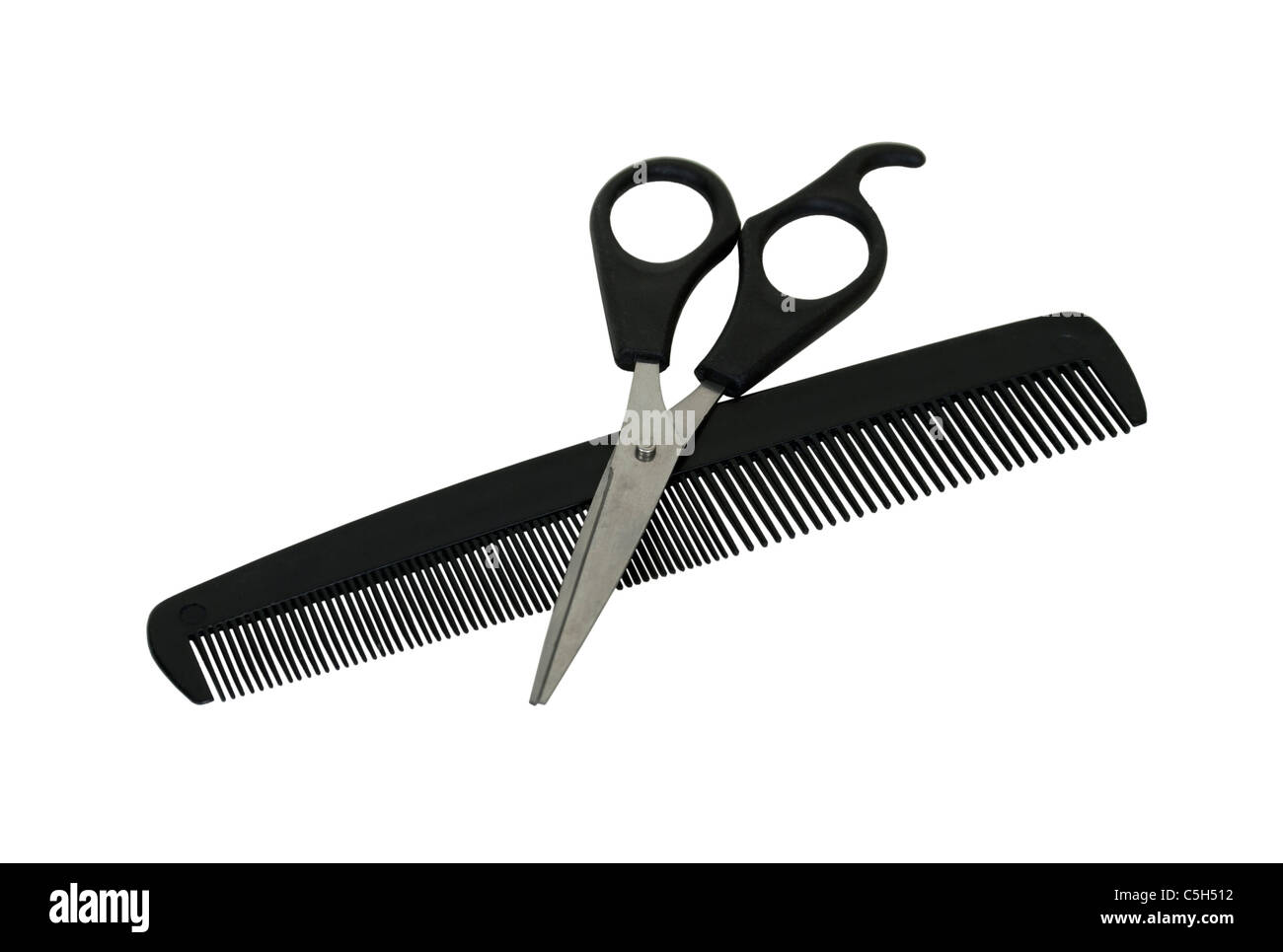 Comb and scissors in preparation to cut hair - path included - Stock Image