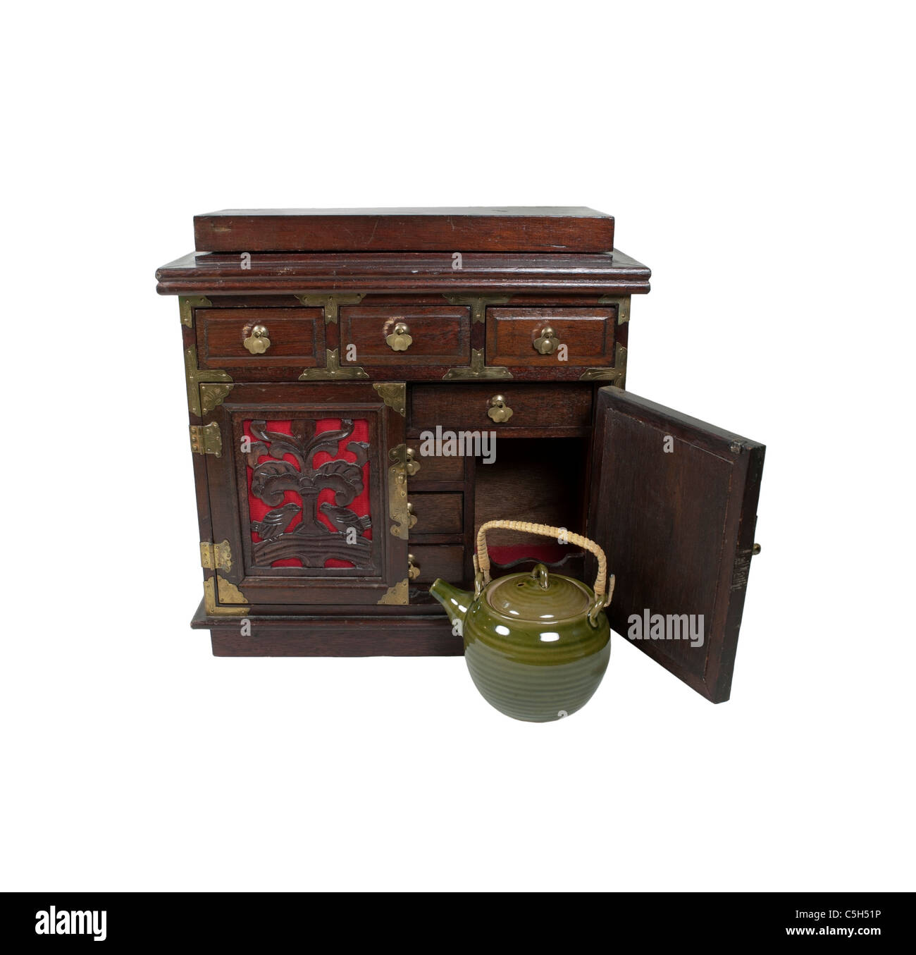 An old antique tea pot and chest with small drawers for storing various ingredients - path included - Stock Image