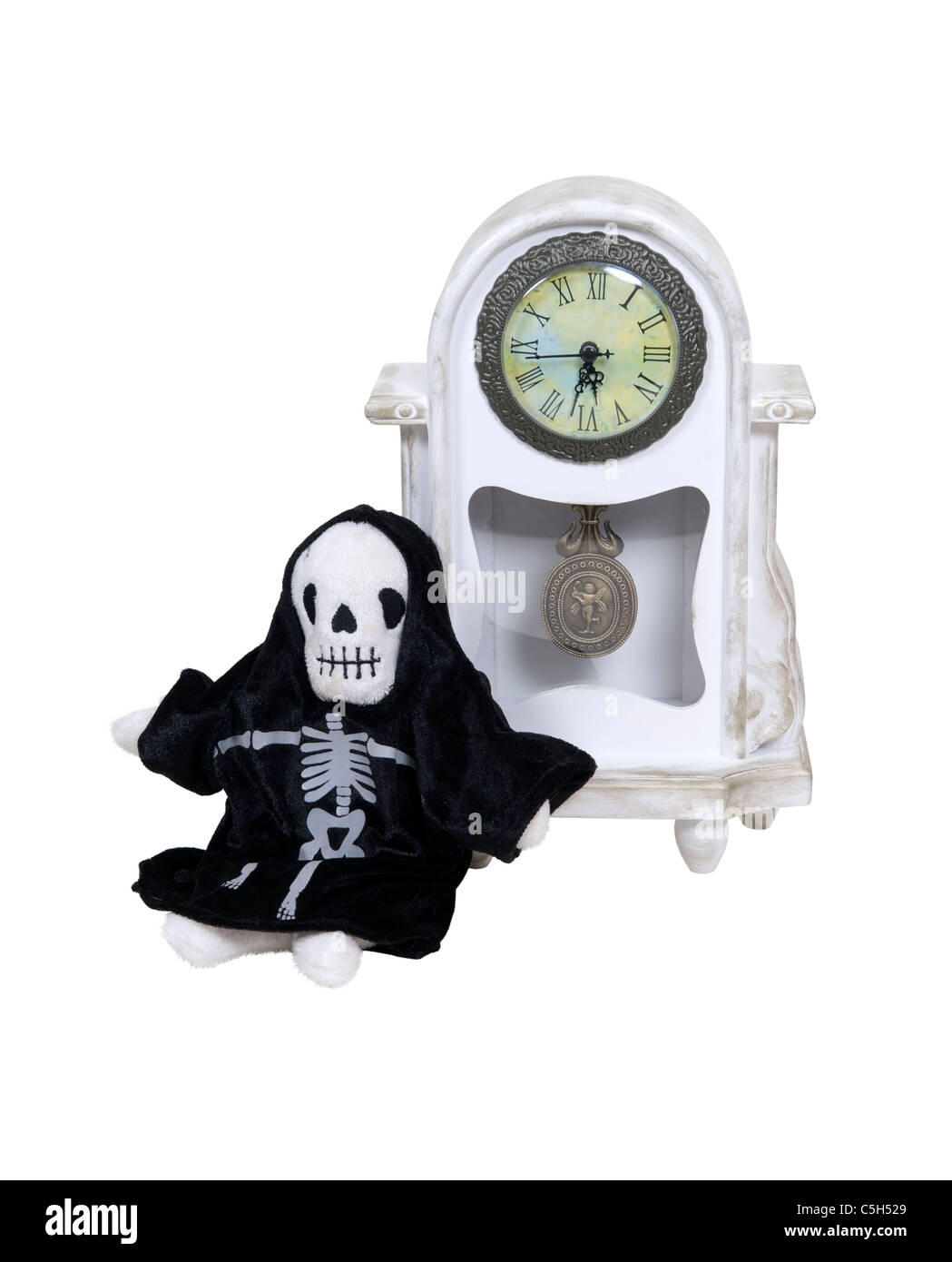 Time is running short with death incarnated leaning against a formal clock to measure time passing - path included Stock Photo