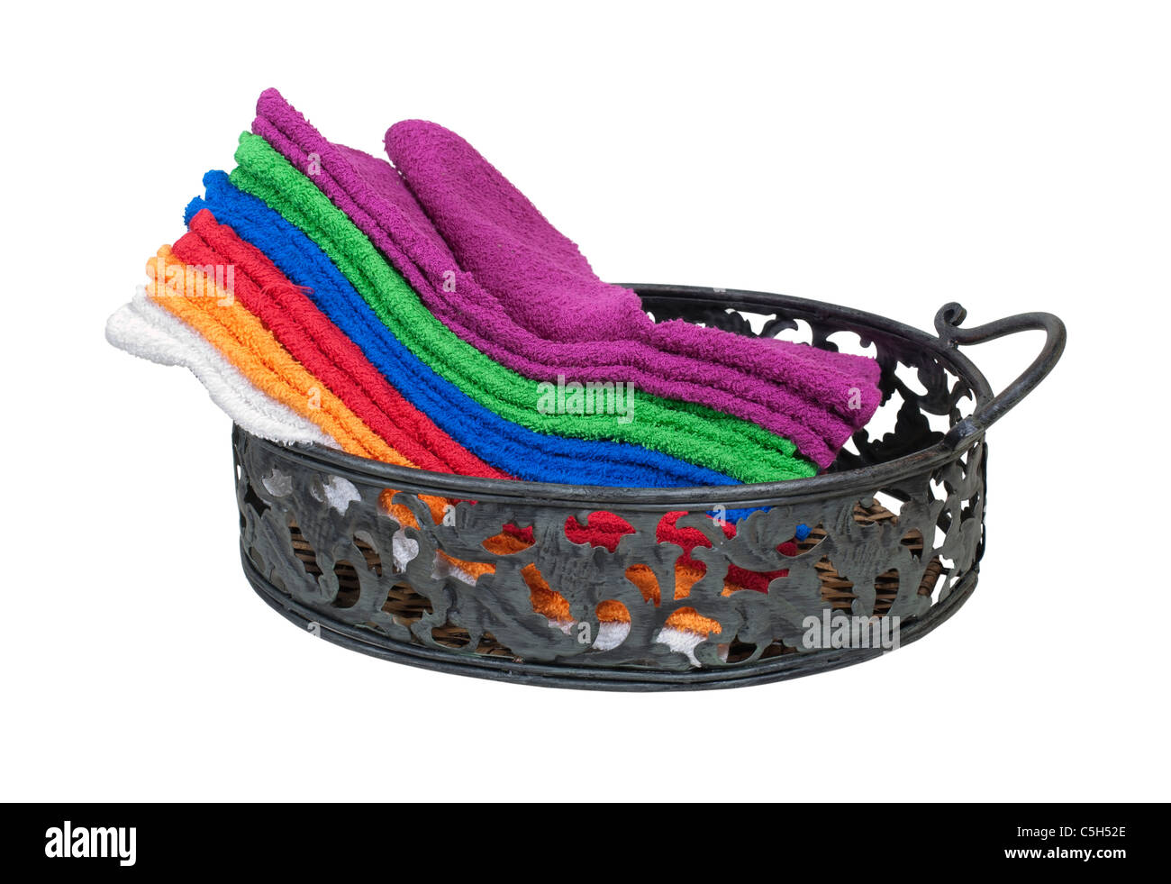 Collection of colorful towels for everyday use in a serving tray - path included - Stock Image