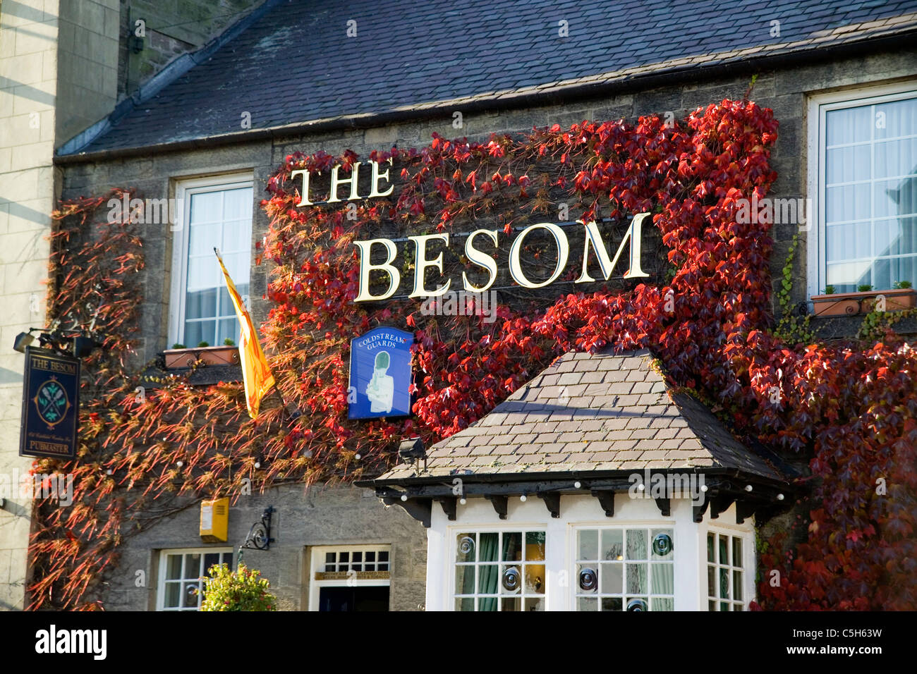 The Besom Inn Hotel and pub with virginia creeper - Coldstream - Stock Image