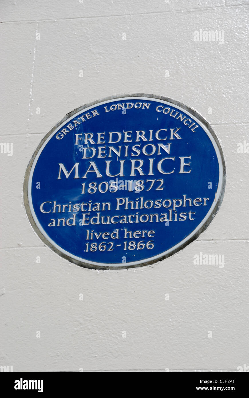 Greater London Council blue plaque marking the former home of English Theologian John Frederick Denison Maurice. - Stock Image