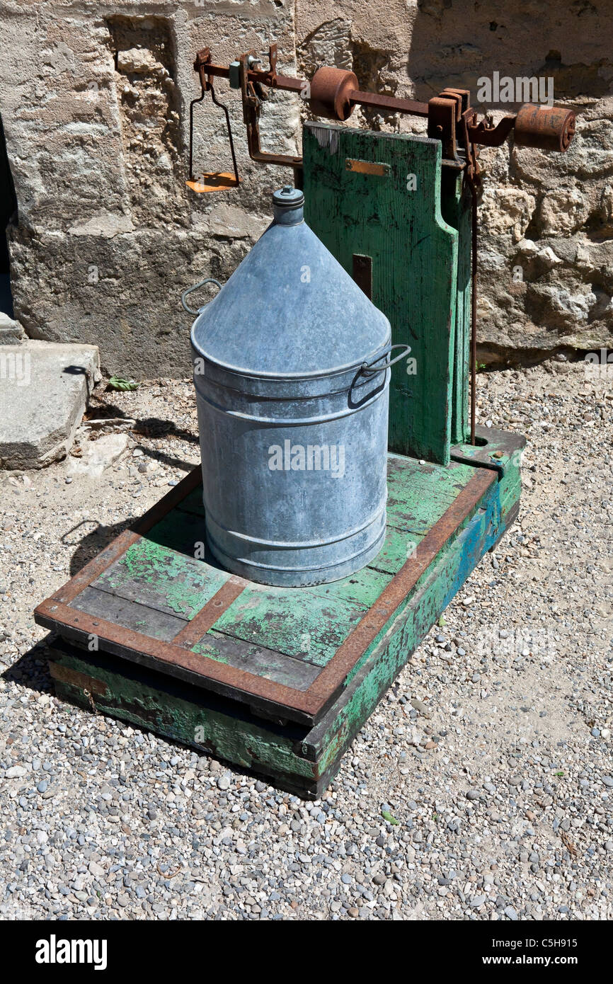 An old oil can on the old scale - Stock Image