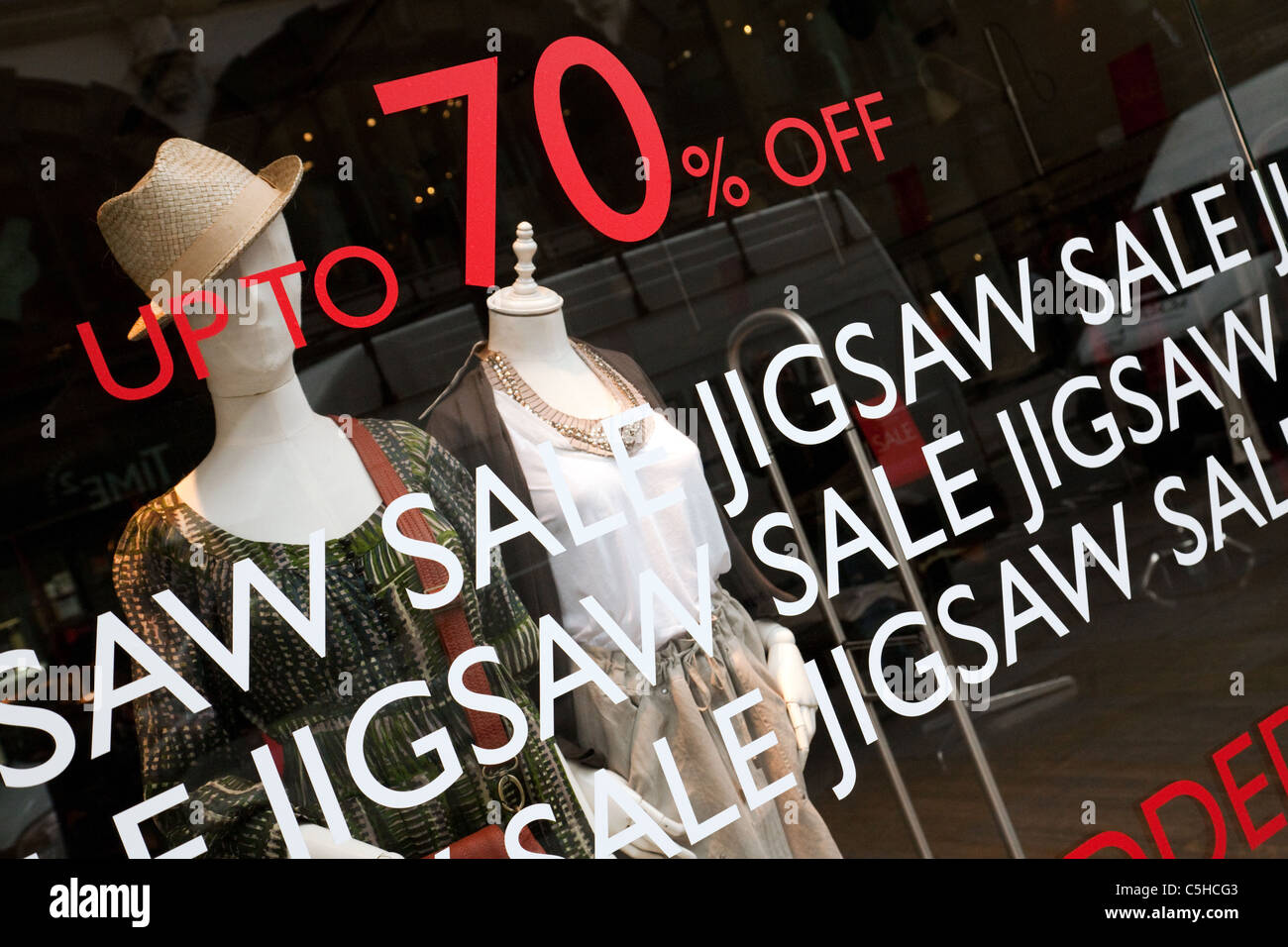 70% off sale sign on window of Jigsaw Ladies clothes storer, Covent Garden, London UK - Stock Image