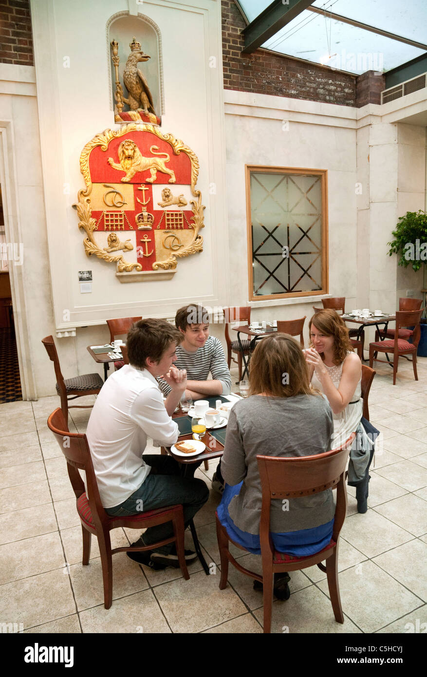 Guests having breakfast at the Royal College of Surgeons, Lincolns Inn Fields, london UK - Stock Image