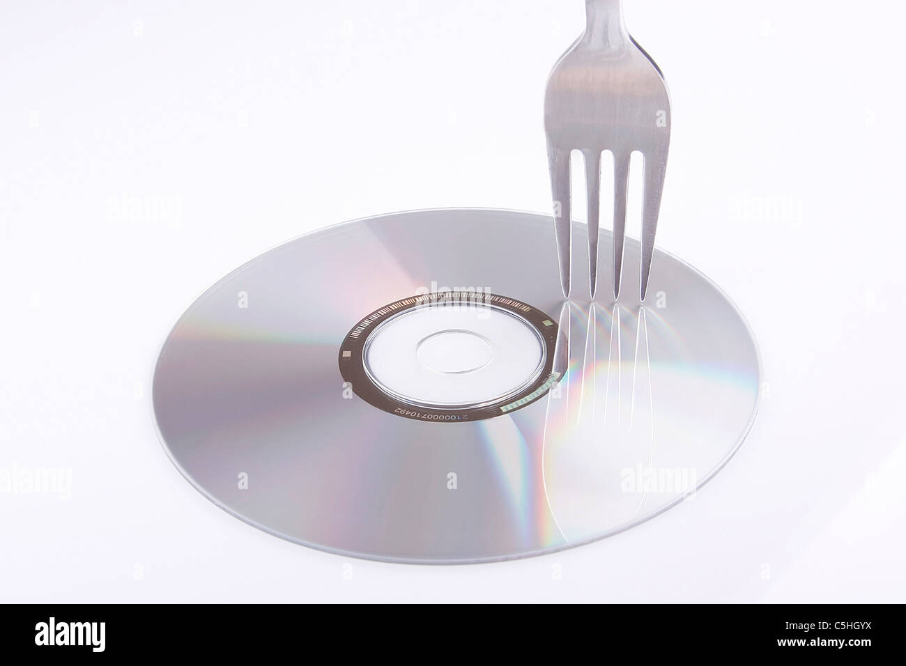 fork sketching compact disc - Stock Image