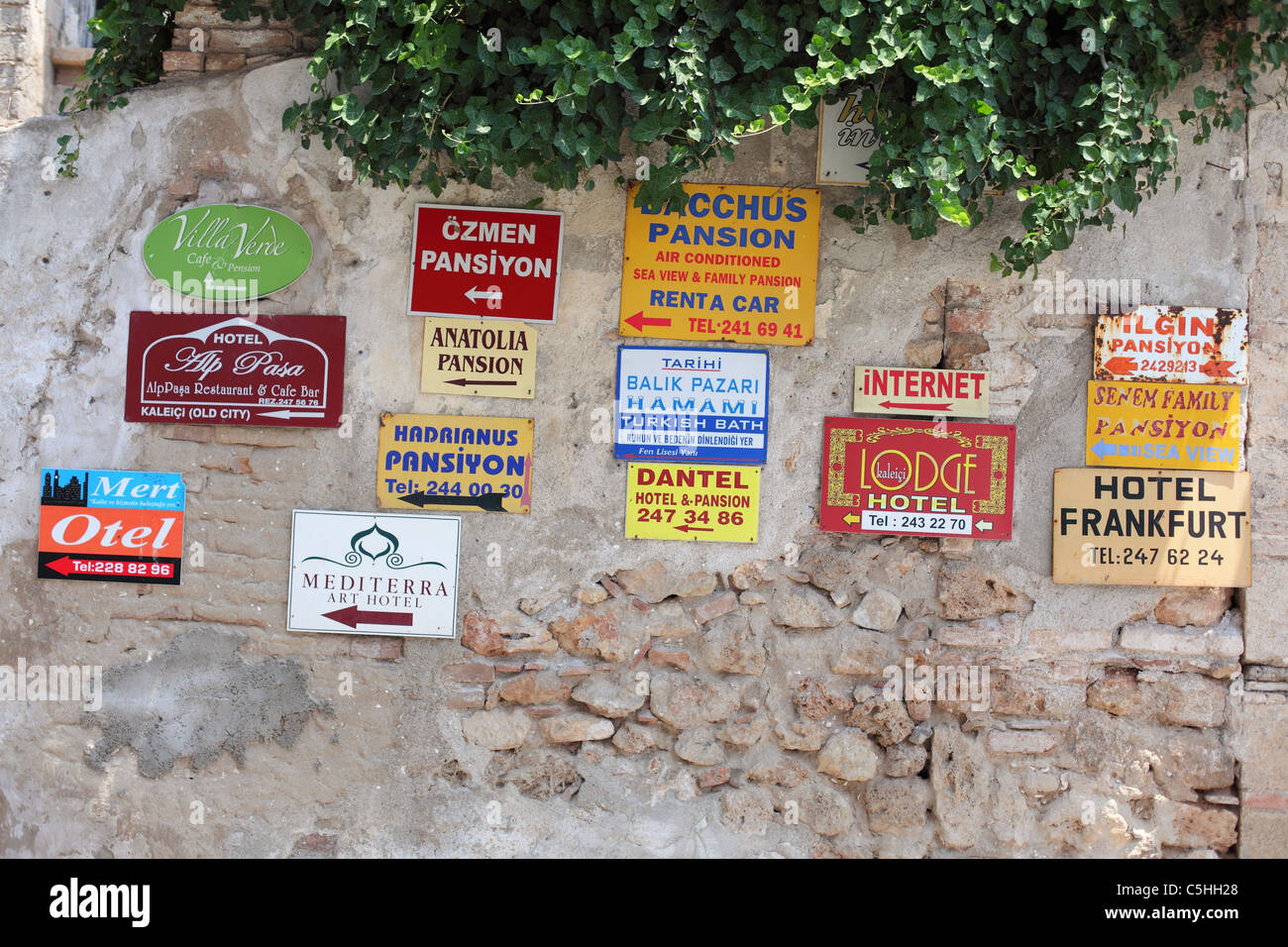 Turkey, Antalya, Kaleici, tourists, tourist, old town, summer, hotel and pension signs - Stock Image