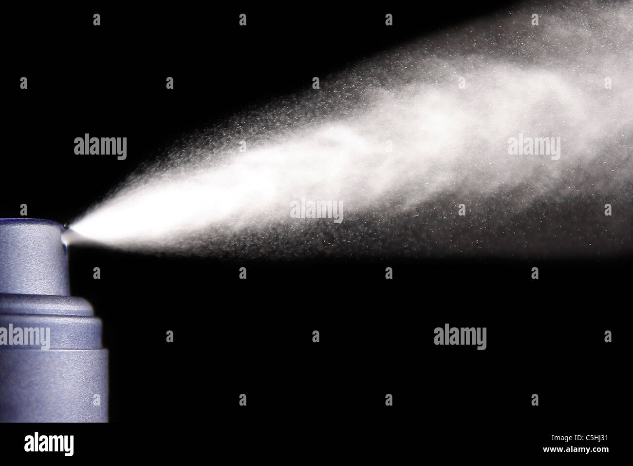 aerosol spray isolated on black background - Stock Image