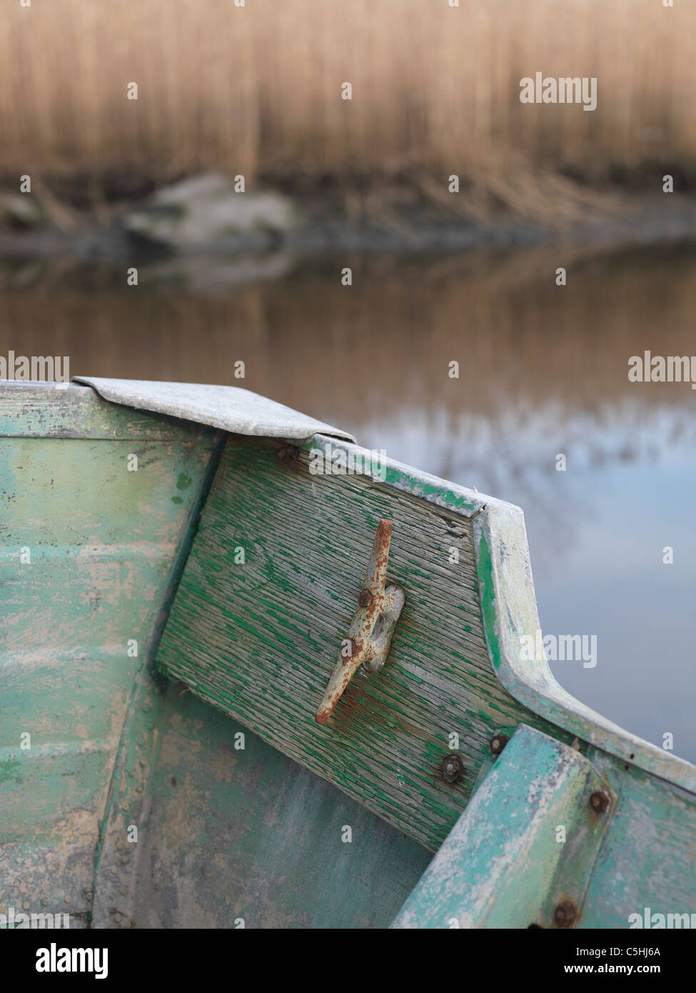 old, patina, flaking, paint, green, blue, rivets, boat, rowing, aluminum, edge, rear, rust, age, color, edge, rear, - Stock Image