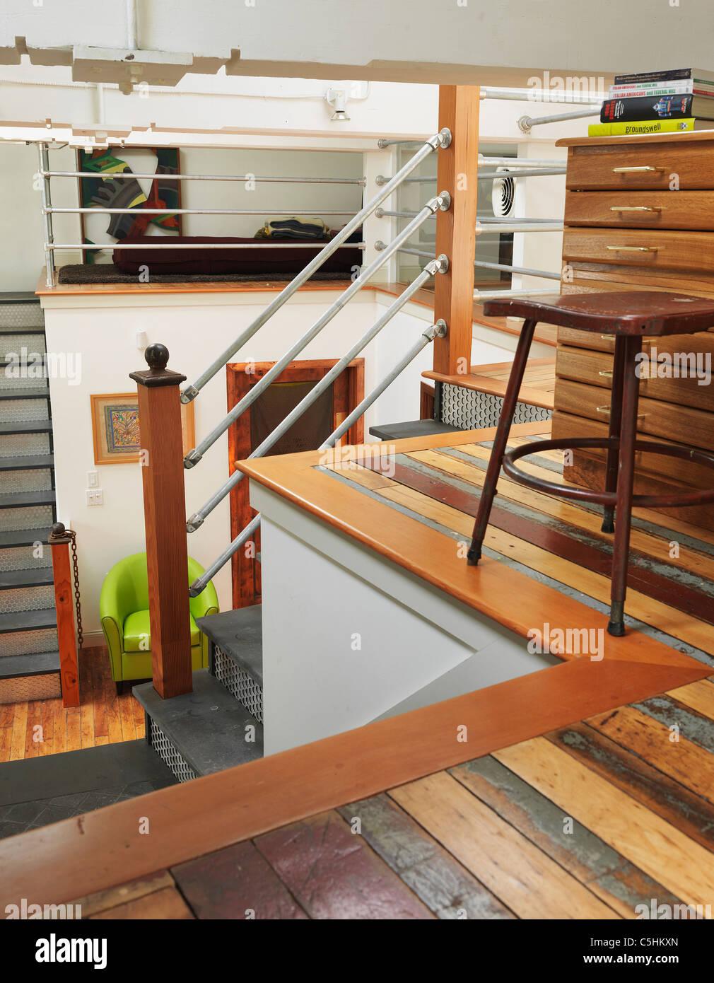 reused flooring in loft home office - Stock Image