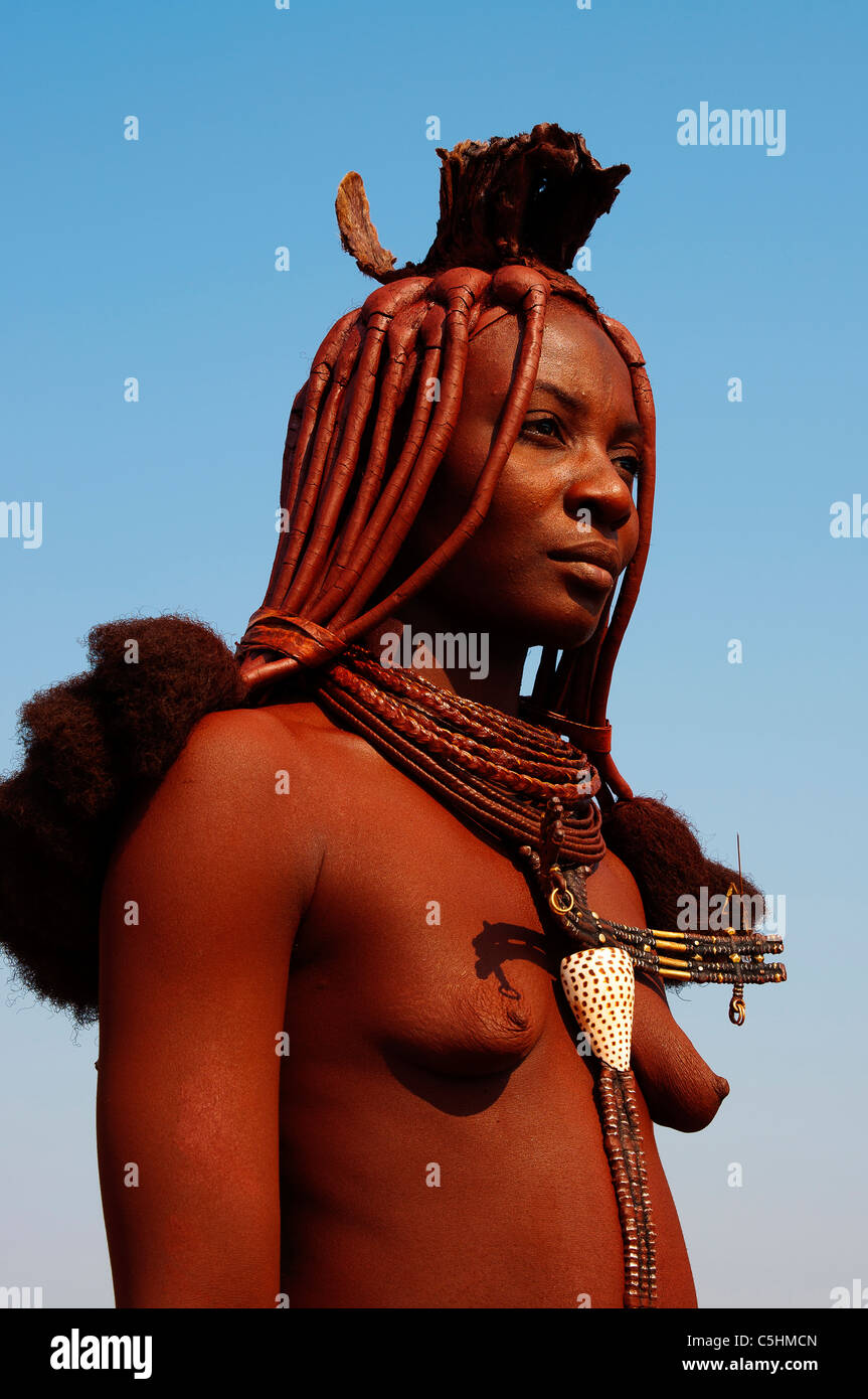 Himba woman on the road to Epupa Falls, northern Namibia - Stock Image