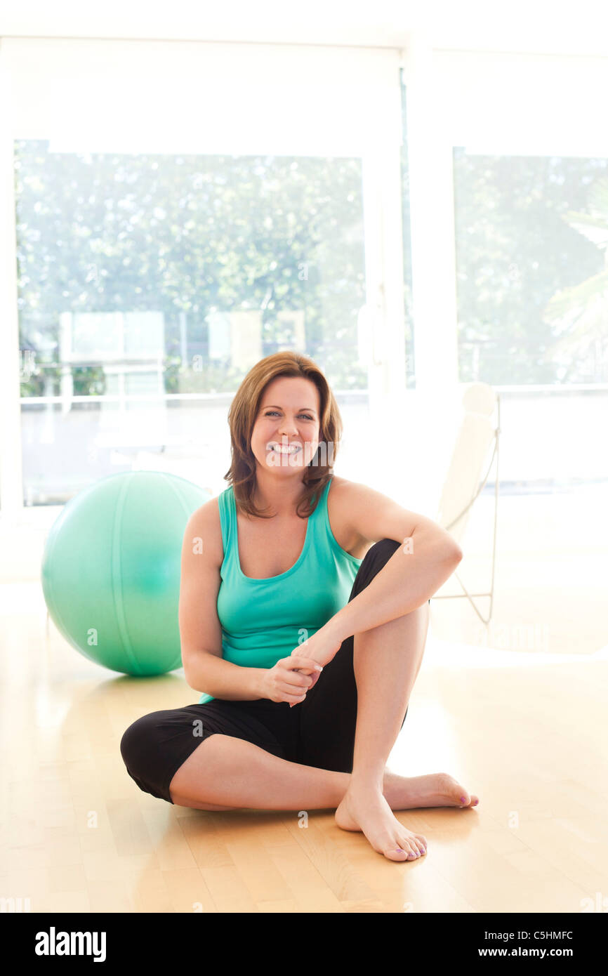 Woman resting after exercise - Stock Image
