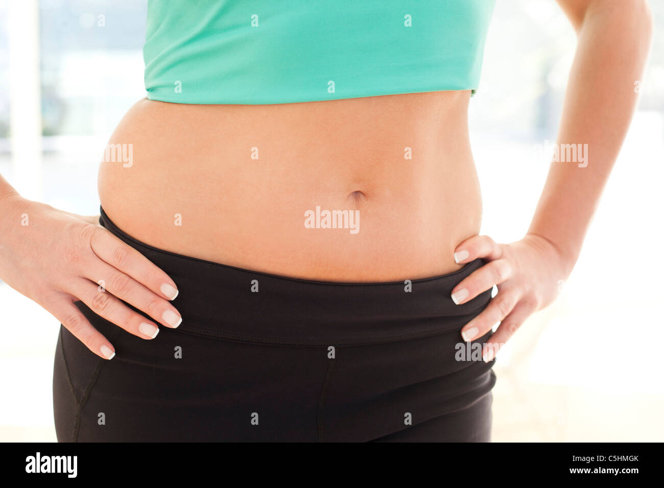 Woman's abdomen - Stock Image