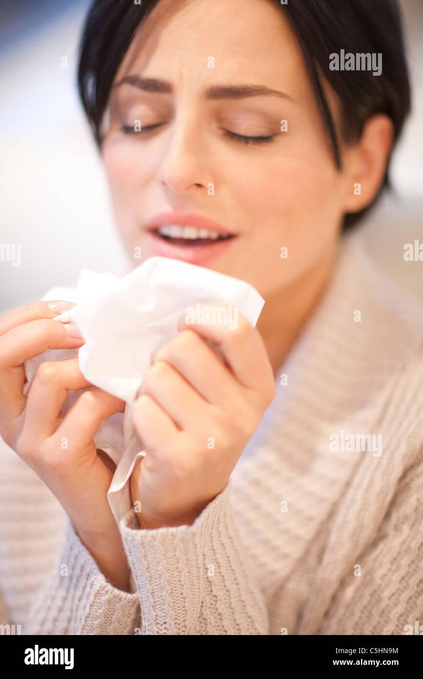 Woman sneezing - Stock Image