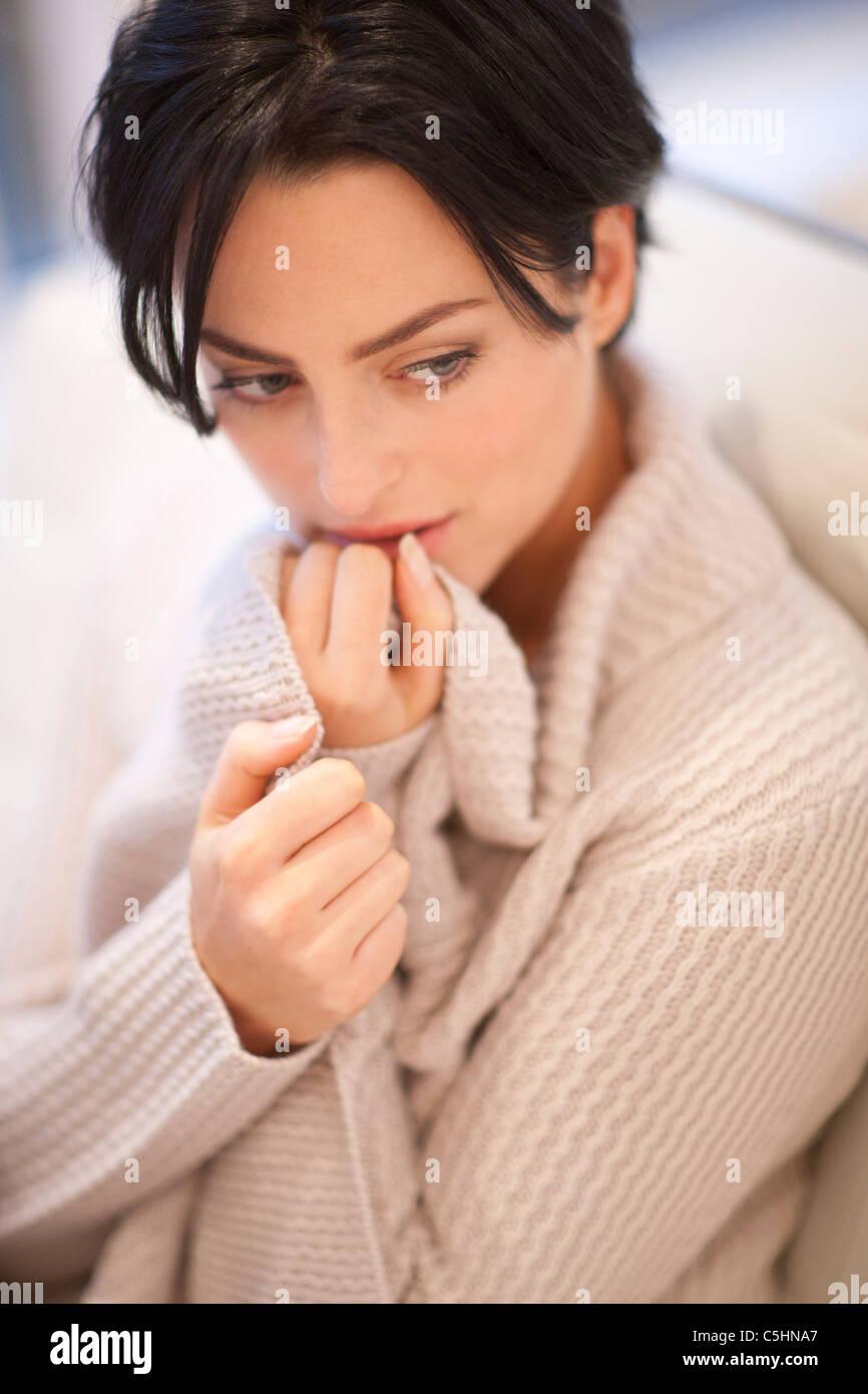 Anxious woman - Stock Image