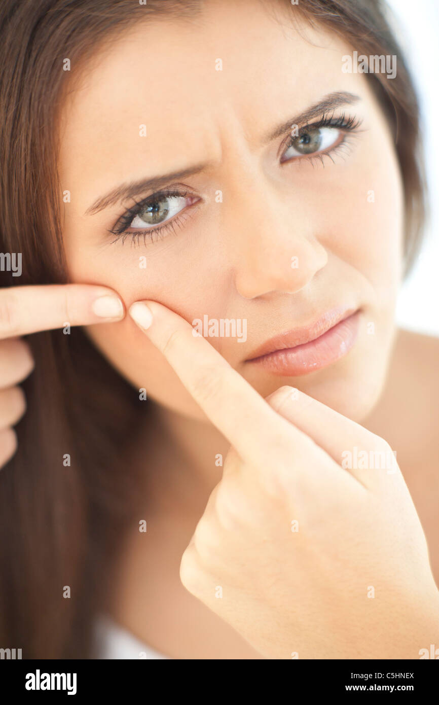Squeezing spot - Stock Image