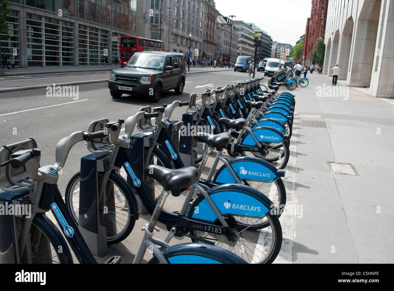 Rack of Barclays Bank Cycle Hire bicycles at a docking station in the City London - Stock Image