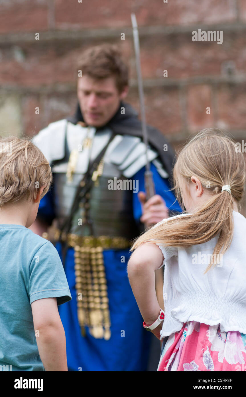 Man dressed as a Roman soldier, teaches children about Roman Chester. Cheshire, UK - Stock Image