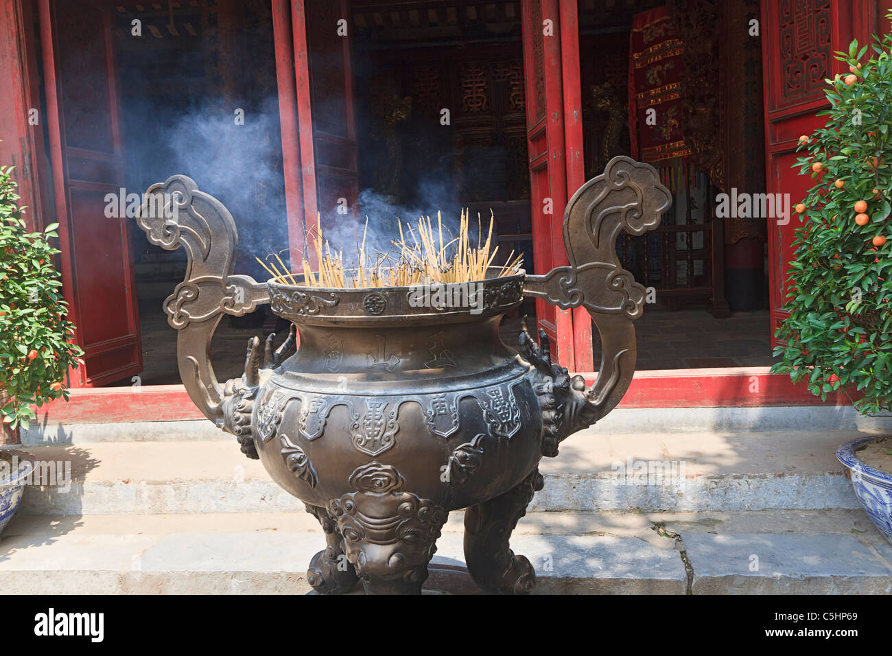 Incense offering at Ngoc Son Pagoda (Temple of the Jade Mound), a Buddhist temple on a small island on Hoan Kiem - Stock Image