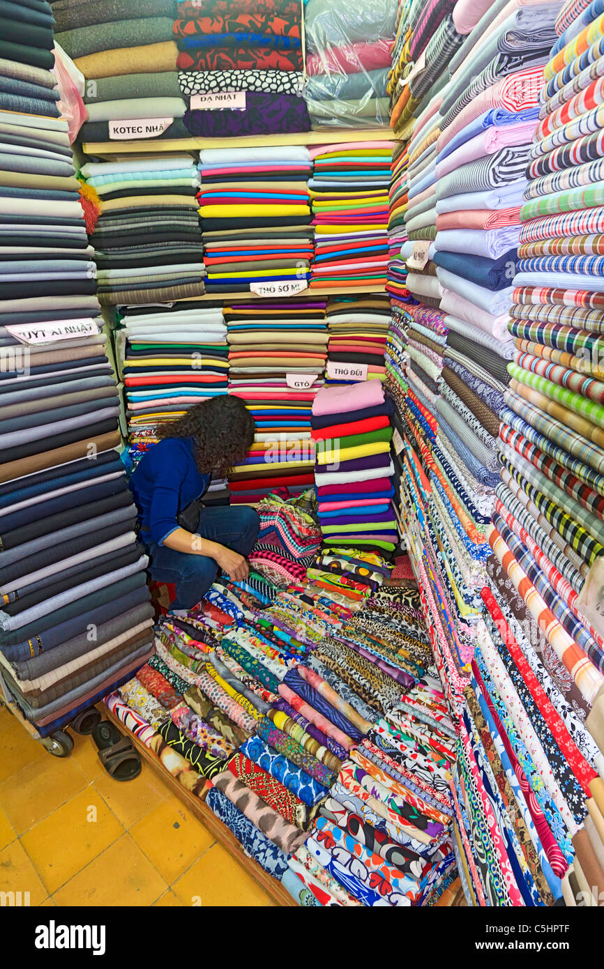 Cloth for sale in Hom Market, a typical crowded market in the Old Quarter of Hanoi Stock Photo