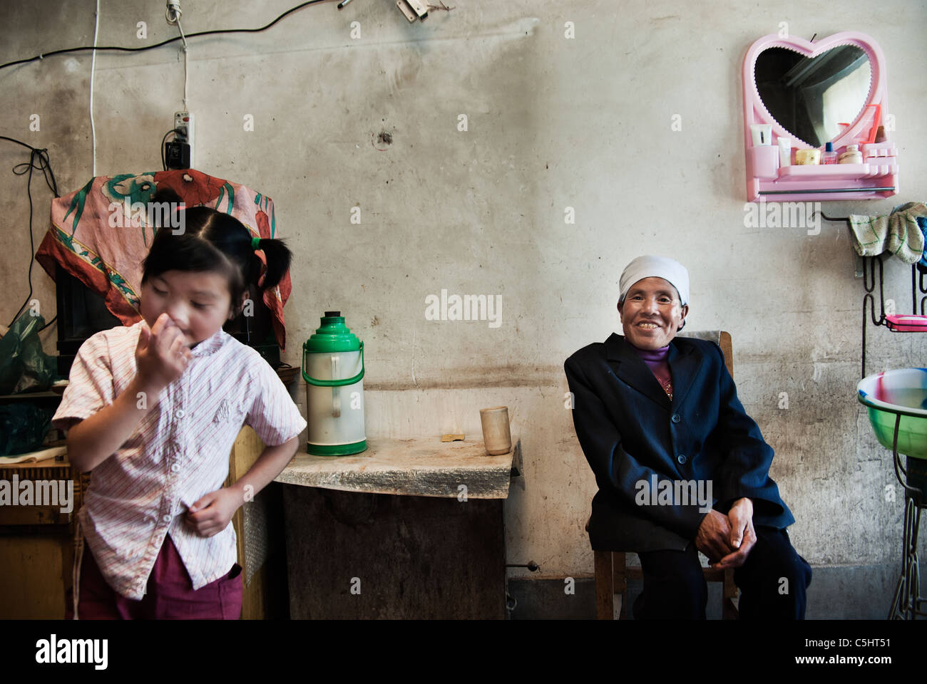 grandmother with granddaughter in her house in a village, ningxia,china - Stock Image