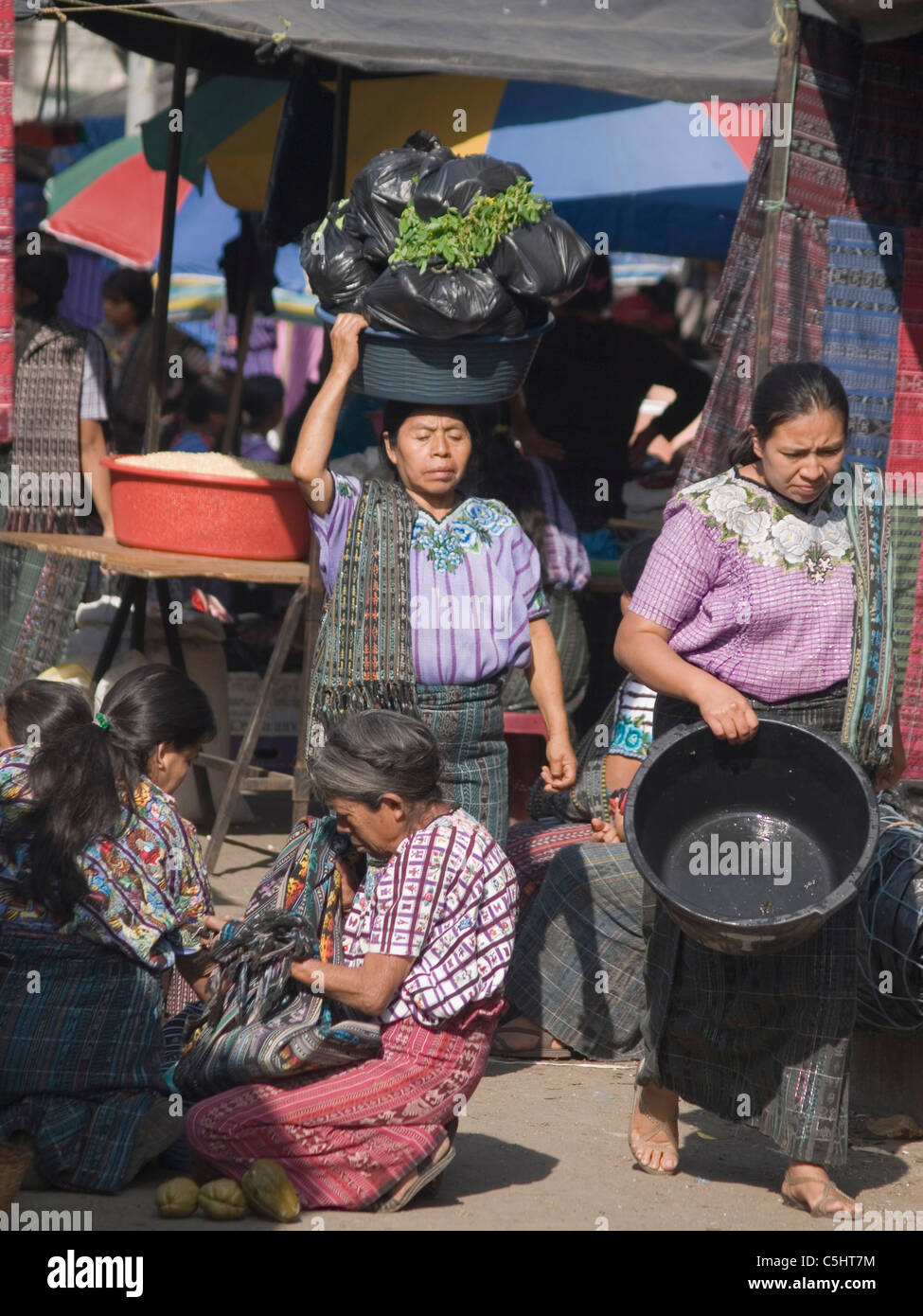 Women in the town market in Santiago Atitlan, Guatemala. - Stock Image
