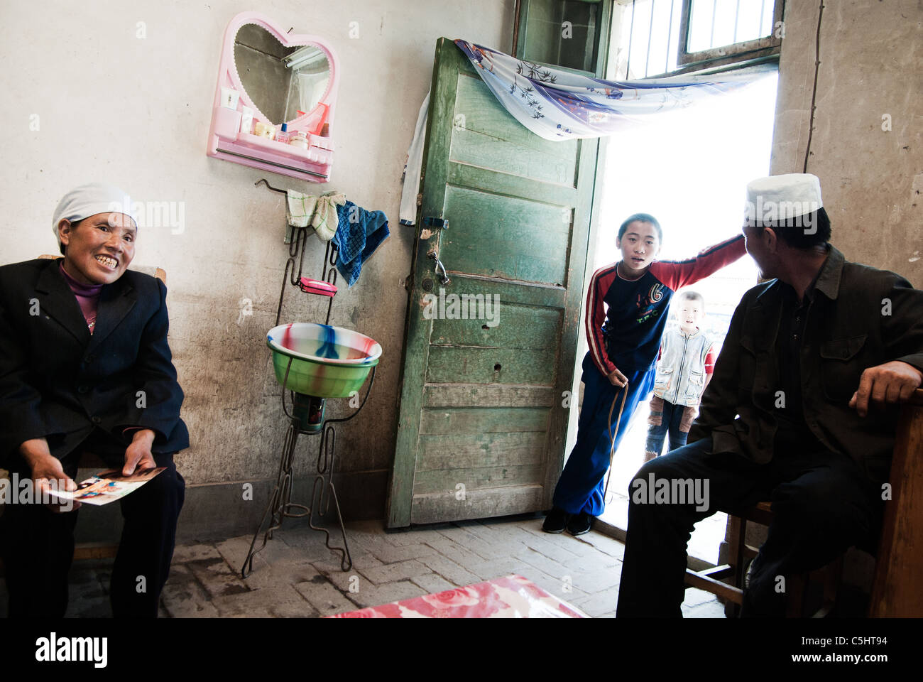 boy in the door of grandmother's house in a village,ningxia,china - Stock Image
