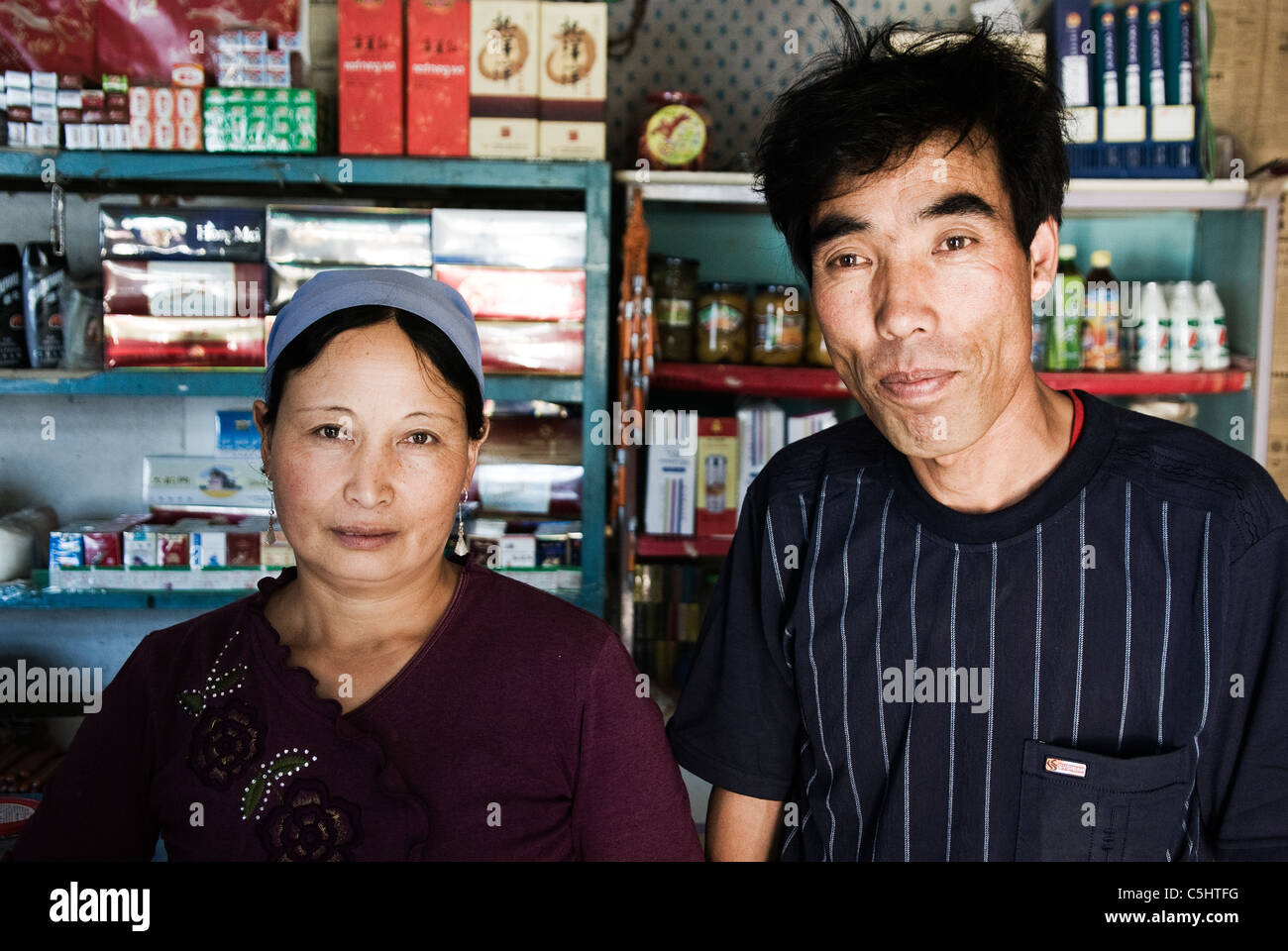 peasant couple in their convenience store in a village in ningxia, china - Stock Image
