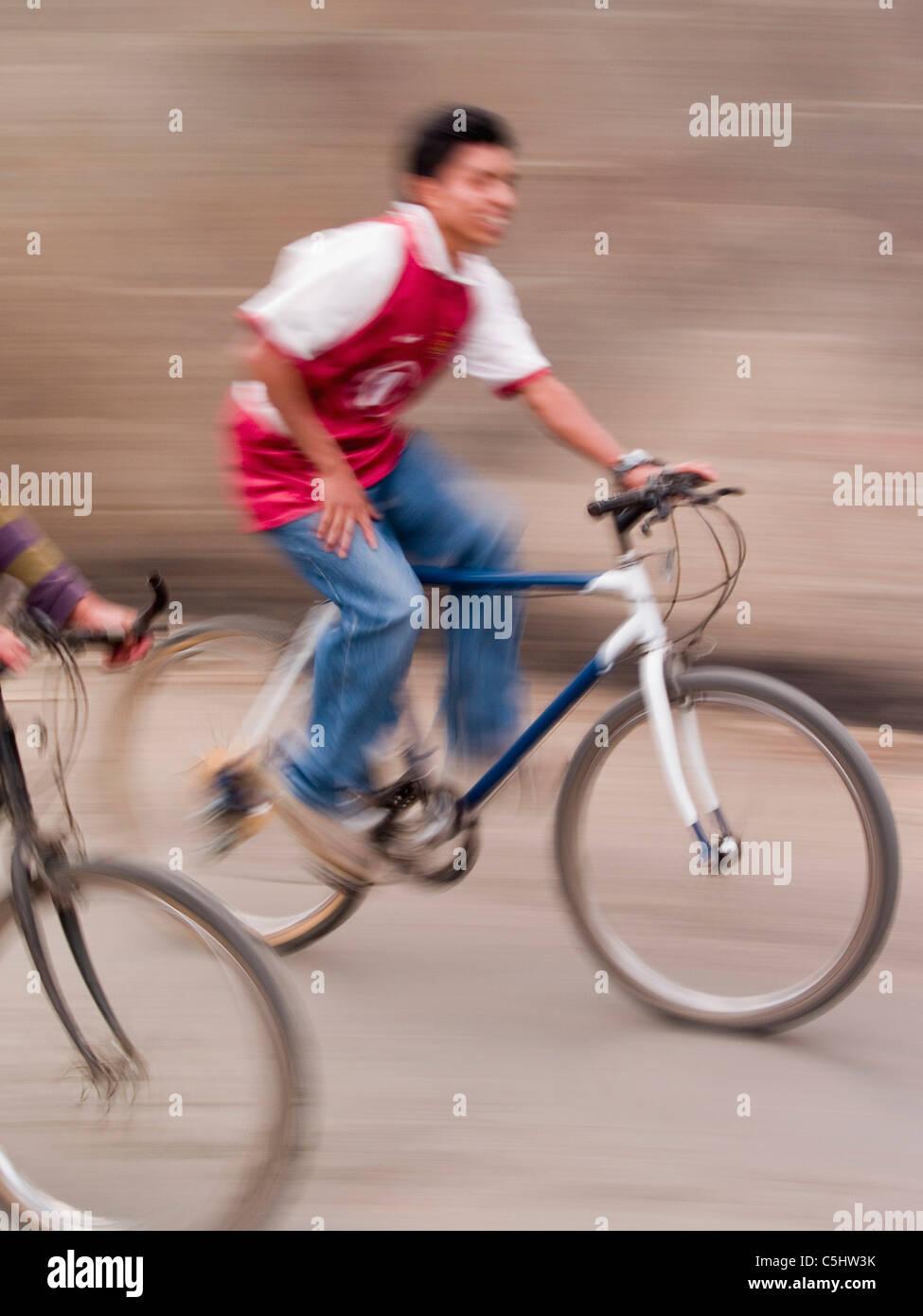 Bicycle rider in Santiago Atitlan, Guatemala - Stock Image