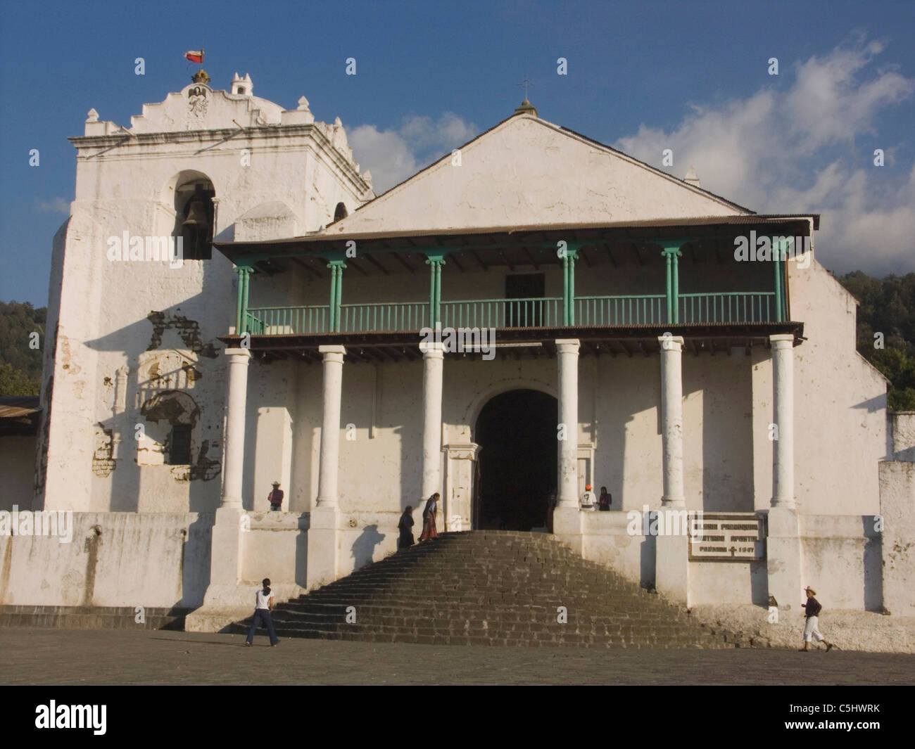 Local people walk up stairs to enter the town's main Catholic church in Santiago Atitlan, in the highlands of - Stock Image