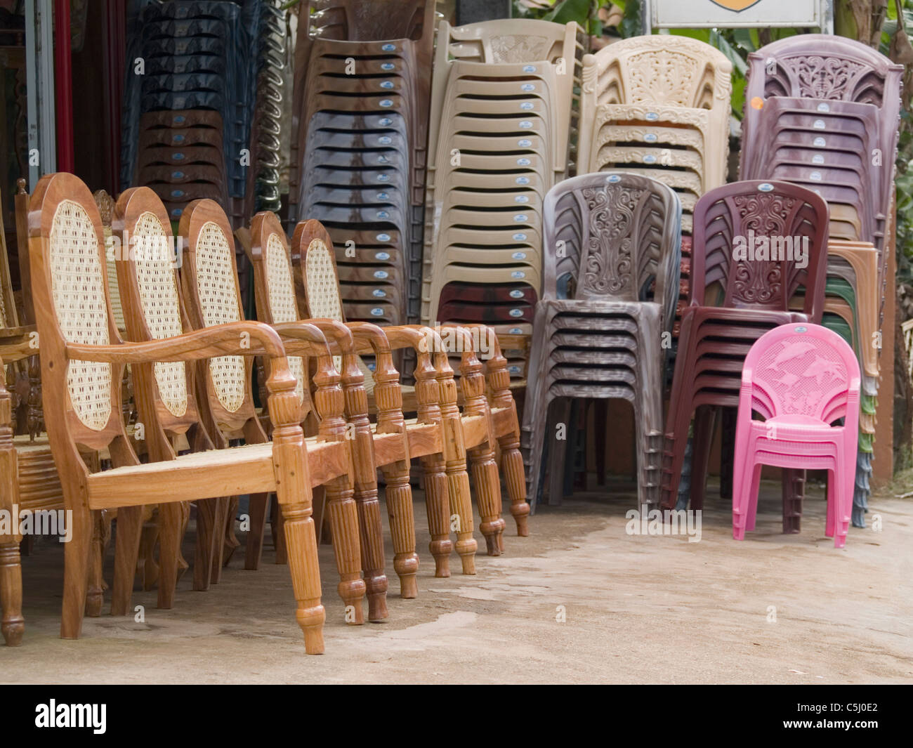Chairs made from plastic and from local materials side by side in a shop outside matara sri lanka