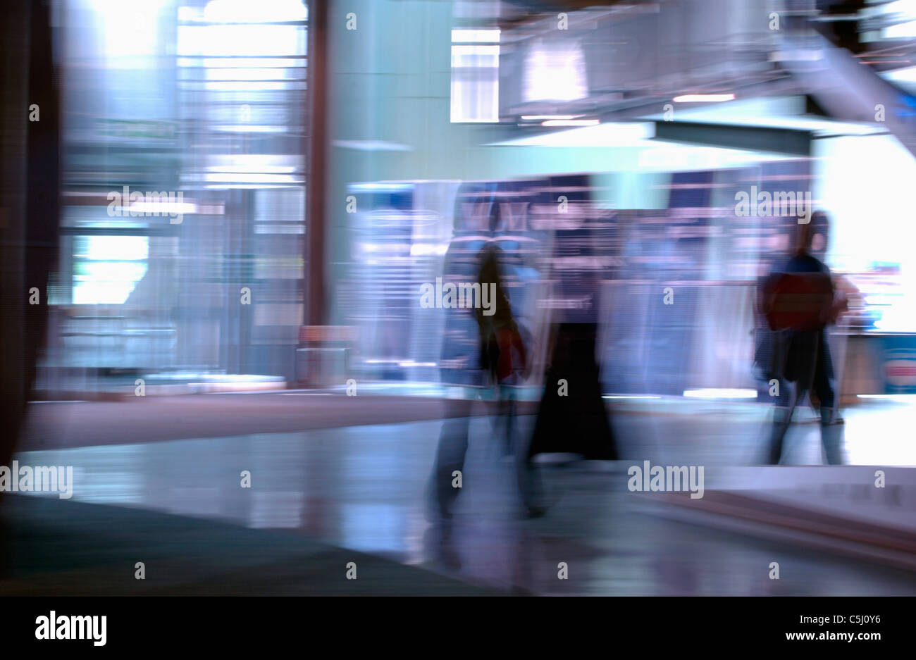 stylised view of people walking with motion blur Stock Photo