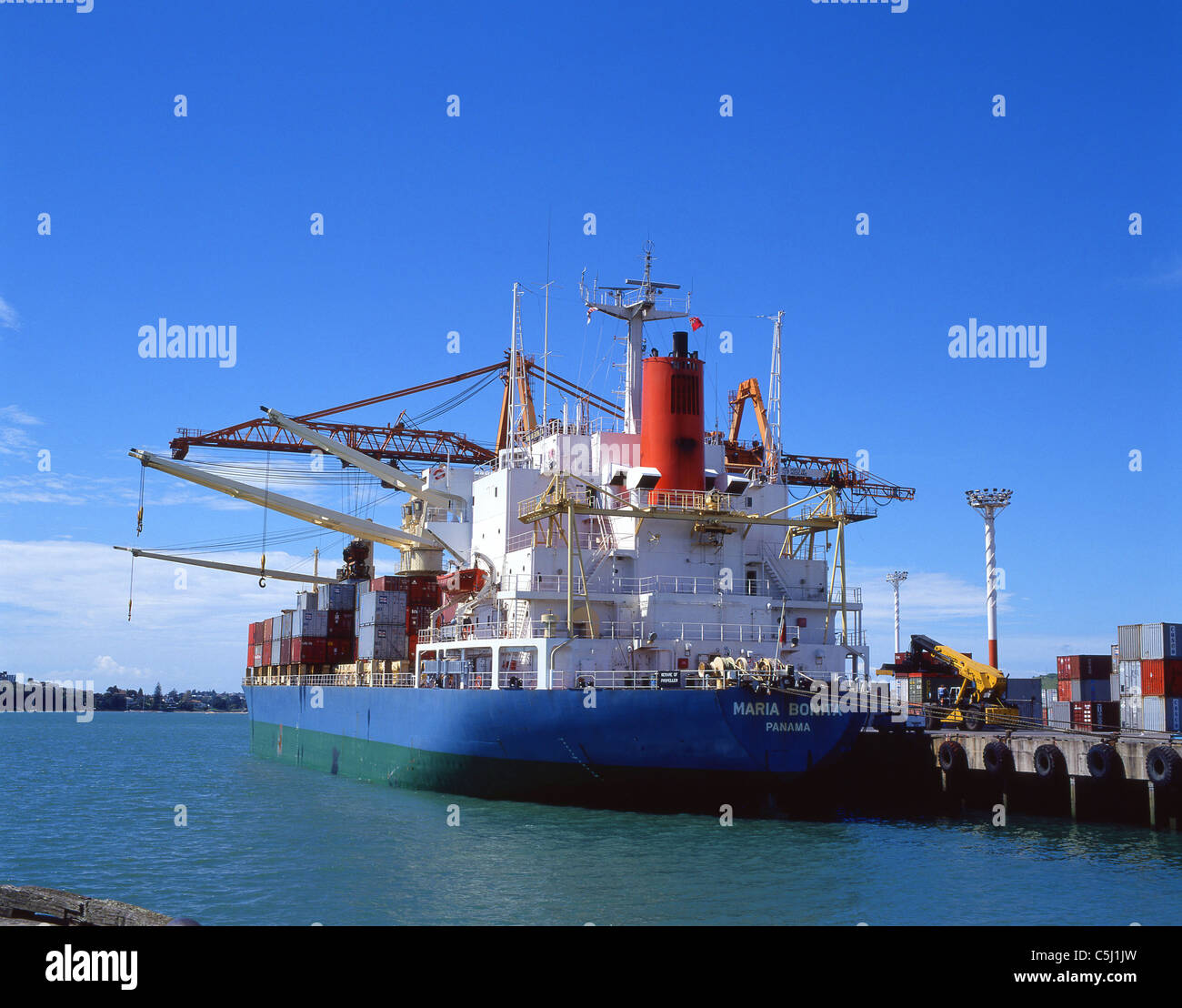 Container ship loading in Auckland Harbour, Auckland, Auckland Region, North Island, New Zealand - Stock Image