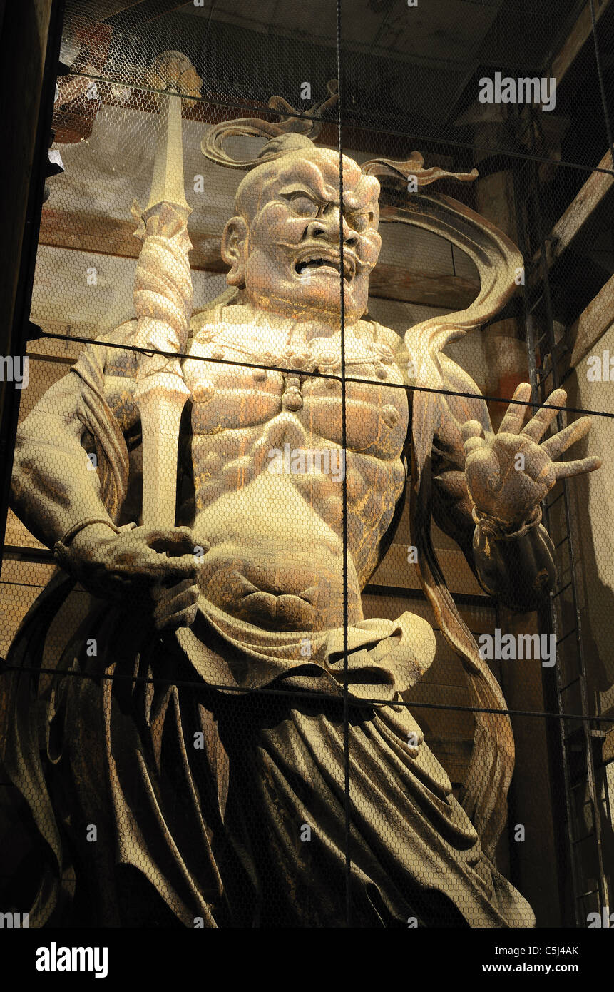 An Oni (demon) at the gate of Todaiji, the world's largest wooden building and a UNESCO World Heritage Site - Stock Image