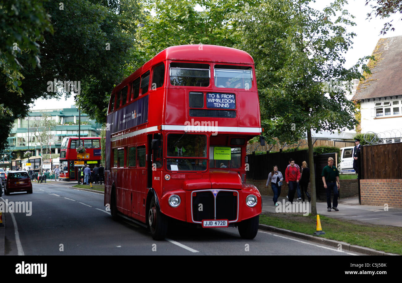 Red doubledecker buses are used as shuttle service at Wimbledon - Stock Image