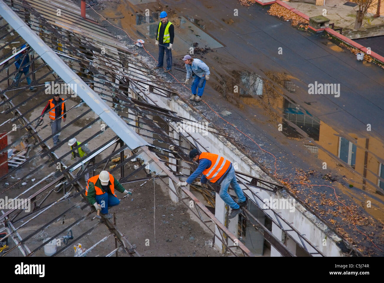 Dismantling glass roof of an old market hall Zizkov district Prague Czech Republic Europe - Stock Image