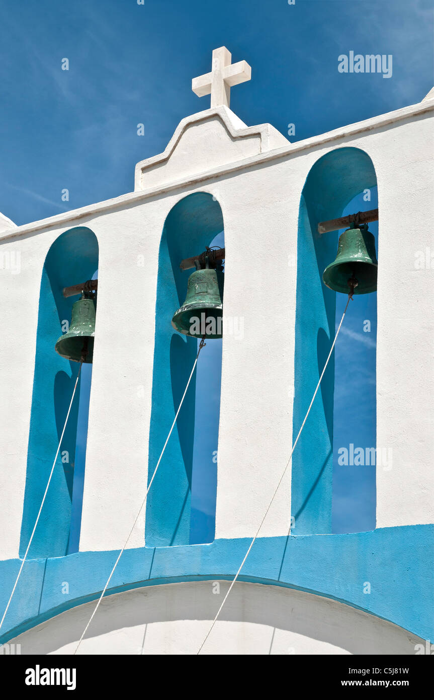 Church bells in the little fishing village of Apollon (Apollonas), Northern, Naxos, Cyclades, Greece - Stock Image