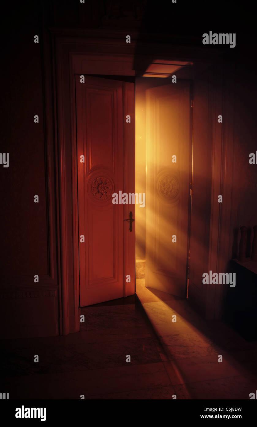 Heavenly rays of light behind the door - Stock Image