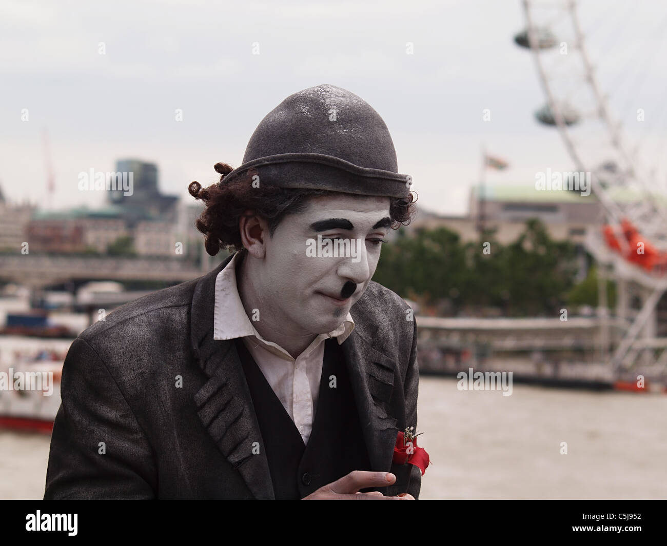 Mime artist busking on Westminster Bridge, London Stock Photo
