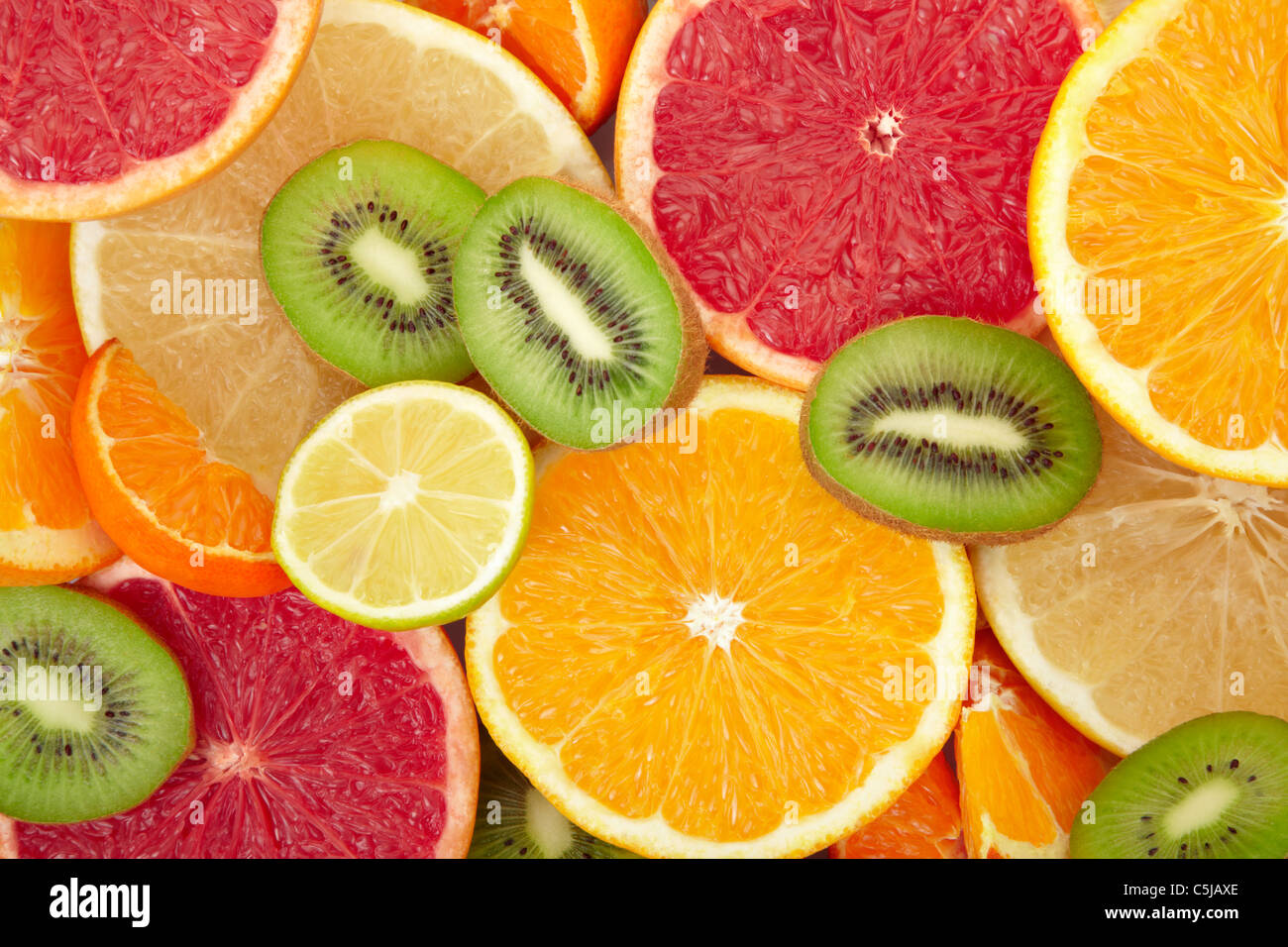 Citrus fruit and kiwi background - Stock Image